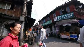 Typical Chinese old town street,shanghai traditional shopping marketplace. Typical Chinese old town street,shanghai traditional Shopping marketplace,busy People stock footage
