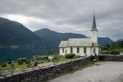 Typical christianity church in Norway. Typical christianity church with cemetery in Norway Stock Images