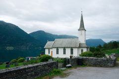 Typical christianity church in Norway. Typical christianity church with cemetery in Norway Royalty Free Stock Photo
