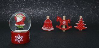 SANTA CLAUS AND RED CHRISTMAS ARTICLE stock photo