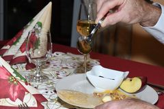 Typical Christmass food religion Waffle with Honey garlic apple walnut and plum. On the table Royalty Free Stock Photo