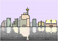 Typical City Skyline at Night. An illustration of an illuminated skyline of a typical modern city situated next to a waterfront. Square pixels of various colors Stock Photography