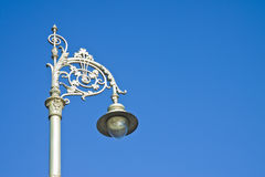 Typical classic Irish streetlight against a blue background - im Royalty Free Stock Photography