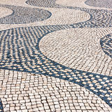 Typical cobblestone pavement iin Lisbon, Portugal Royalty Free Stock Images