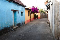 A typical cobblestone street in Huasca de Ocampo. Huasca de Ocampo, Hidalgo, Mexico - 2016: A typical cobblestone street at the town center stock photo