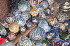 The typical colored pottery on the souk in Marrakech. Kitchen plates found at the souk of Marrakesh in Morocco Royalty Free Stock Images