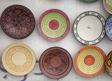 The typical colored pottery on the souk in Marrakech. Kitchen plates found at the souk of Marrakesh in Morocco Royalty Free Stock Photo