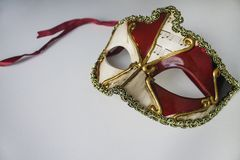 Typical colored venetian mask. A typical colored venetian mask stock images