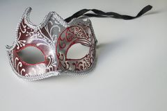 Typical colored venetian mask. A typical colored venetian mask stock photography