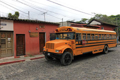 Typical colorful guatemalan chicken bus in Antigua, Guatemala Royalty Free Stock Images