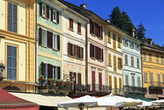 Typical colorful houses on blue sky, Orta St. Giulio village, Orta lake, Piedmont, Italy. stock images