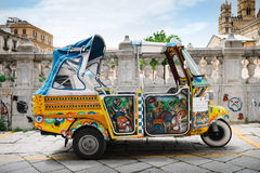 Typical colorful taxis for tourists. Palermo, Italy - May 12, 2016: Taxi for tourists parked near the Cathedral of Palermo Royalty Free Stock Images