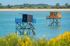 Typical and colorful wooden fishing huts on stilts in the atlantic ocean near La Rochelle France. Typical and colorful wooden fishing huts on stilts in the royalty free stock photo