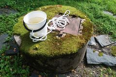 Typical concrete water well with moss Stock Image