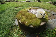 Typical concrete water well with moss Stock Photos