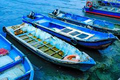 Fishermen boats parking on the shore stock photography
