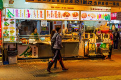 Typical cookshop in Kowloon, Hong Kong, at night Royalty Free Stock Photography