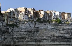 Typical Corsican houses on a cliff overlooking the sea in the port of Bonifacio Stock Images
