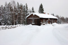 Typical cottage in Sweden. Typical Swedish cottage in the countryside, Sweden during a snowy winter Royalty Free Stock Photos