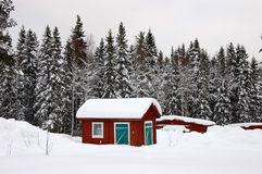 Typical cottage in Sweden. Typical Swedish red cottage in the countryside, Sweden during a snowy winter Stock Photo