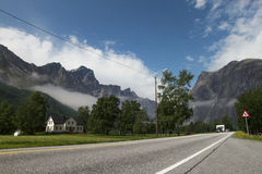 Typical country house in a middle of the mounains,Norway Europe. Capmer on the road Royalty Free Stock Photos