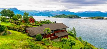 Free Typical Countryside Norwegian Landscape With Red Painted Houses On The Shore Of The Fjord. Cloudy Summer Morning In Norway, Europe Royalty Free Stock Photo - 146554845
