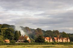 Typical countryside scene in Oxfordshire, England. A typical view of rural housing surrounded by countryside in rural Oxfordshire, England, in early autumn Royalty Free Stock Photo