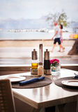 Typical cozy summer cafe with sea view in small resort town on M. Allorca island, Spain Stock Image