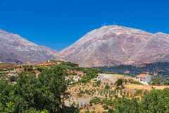 Typical Cretan landscape. Hills, olives and wind-power usage Stock Photography