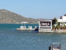 Cretan Restaurant. Typical cretan restaurant by the sea in Elounda Royalty Free Stock Images