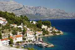 A typical Croatian village. On the Mediterranean Sea and Biokovo mountains in background Stock Photos