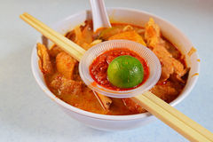 Typical Curry Noodle with Chili Paste and Lime Royalty Free Stock Images
