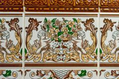 Typical decoration of the facade of the house in Lisbon. Traditional ceramic tiles Azulejos.  stock images
