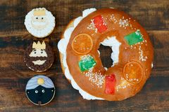 Spanish Christmas cake with three cookies of the Three Wise Men. Typical dessert eaten in Spain to celebrate Epiphany with three cookies of the Three Wise Men Stock Images