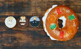 Spanish Christmas cake with three cookies of the Three Wise Men. Typical dessert eaten in Spain to celebrate Epiphany with three cookies of the Three Wise Men Stock Photography