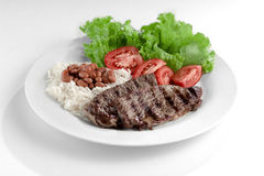 Typical dish of Brazil, rice and beans. This is the most common dish in Brazil, rice, beans, steak and tomato salad with lettuce Stock Images