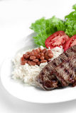 Typical dish of Brazil, rice and beans. This is the most common dish in Brazil, rice, beans, steak and tomato salad with lettuce Stock Image