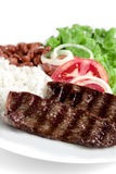 Typical dish of Brazil, rice and beans. This is the most common dish in Brazil, rice, beans, steak and tomato salad with lettuce Royalty Free Stock Photos