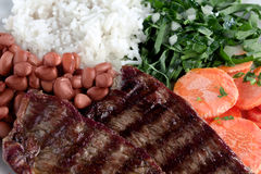 Typical dish of Brazil, rice and beans. This is the most common dish in Brazil, rice, beans, steak and tomato salad with lettuce Royalty Free Stock Image