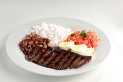 Typical dish of Brazil, rice and beans. This is the most common dish in Brazil, rice, beans, steak and tomato salad with lettuce Royalty Free Stock Images