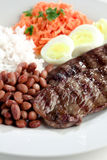 Typical dish of Brazil, rice and beans. This is the most common dish in Brazil, rice, beans, steak and tomato salad with lettuce Stock Photo
