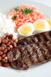 Typical dish of Brazil, rice and beans. This is the most common dish in Brazil, rice, beans, steak and tomato salad with lettuce Stock Photos