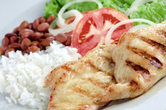 Typical dish of Brazil, rice and beans. This is the most common dish in Brazil, rice, beans, steak and tomato salad with lettuce Royalty Free Stock Photography