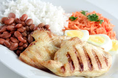 Typical dish of Brazil, rice and beans. This is the most common dish in Brazil, rice, beans, steak and tomato salad with lettuce Stock Photography