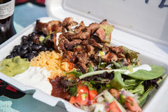 Typical dish out of a food truck in New York. City stock image