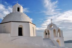 Typical dome of an Orthodox Greek church in the Cycladic Islands. Here we are at Oia in Santorini Stock Photos