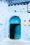 A typical door in the city of Chaouen. A characteristic blue door in the city of Chaouen stock photos