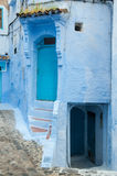 A typical door in the city of Chaouen. A characteristic blue door in the city of Chaouen stock images