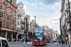 Typical double decker bus in London. LONDON -AUGUST 4:Typical double decker buses in The Picadilly St on August 4, 2014 in London.Piccadilly is one of the widest Royalty Free Stock Images