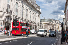 Typical double decker buses in London. LONDON -AUGUST 4:Typical double decker buses in The Picadilly St on August 4, 2014 in London.Piccadilly is one of the Stock Photography